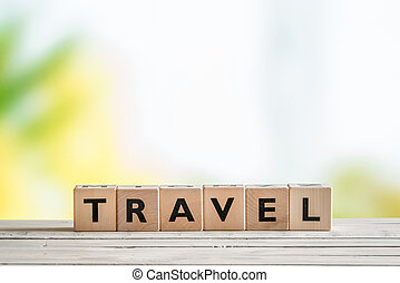 Travel sign on a wooden table
