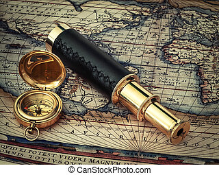 traveling theme: vintage telescope and compass at antique...