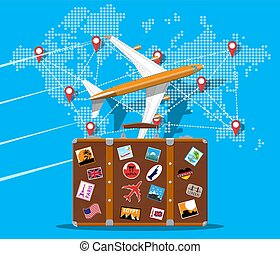 Travel suitcase, airplane and world map