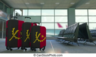 Travel suitcases featuring flag of Angola. Angolan tourism...