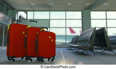Travel suitcases featuring flag of China. Chinese tourism...