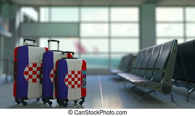Travel suitcases featuring flag of Croatia. Croatian tourism...