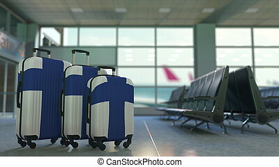 Travel suitcases featuring flag of Finland. Finnish tourism conceptual 3D rendering