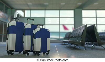 Travel suitcases featuring flag of Finland. Finnish tourism...