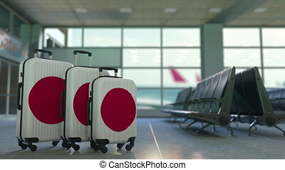Travel suitcases featuring flag of Japan. Japanese tourism...