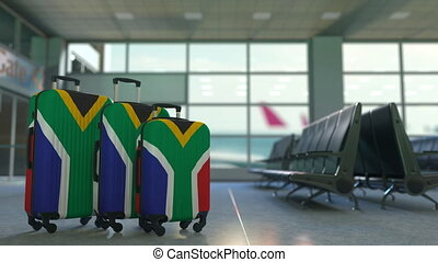 Travel suitcases featuring flag of South Africa. SAR tourism conceptual animation
