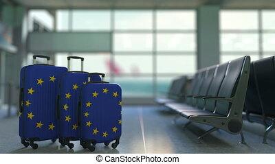 Travel suitcases featuring flag of the European Union. EU...
