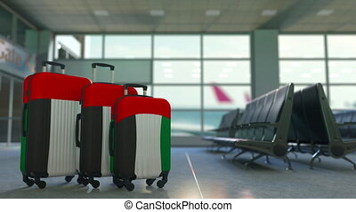 Travel suitcases featuring flag of the United Arab Emirates. UAE tourism conceptual animation