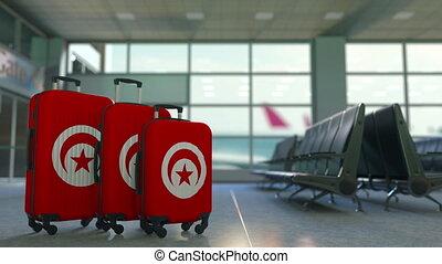 Travel suitcases featuring flag of Tunisia. Tunisian tourism...