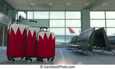Travel suitcases with flag of Bahrain. Bahraini tourism conceptual animation