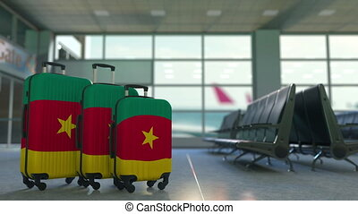 Travel suitcases with flag of Cameroon. Cameroonian tourism...