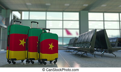 Travel suitcases with flag of Cameroon. Cameroonian tourism conceptual 3D rendering