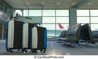 Travel suitcases with flag of Estonia. Estonian tourism conceptual 3D rendering