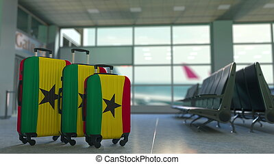 Travel suitcases with flag of Ghana. Ghanaian tourism conceptual 3D rendering