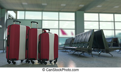 Travel suitcases with flag of Latvia. Latvian tourism conceptual 3D rendering