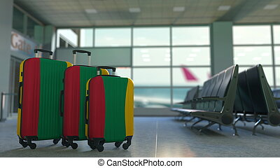 Travel suitcases with flag of Lithuania. Lithuanian tourism conceptual 3D rendering