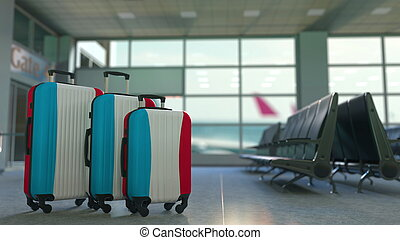 Travel suitcases with flag of Luxembourgh. Luxembourghian tourism conceptual 3D rendering