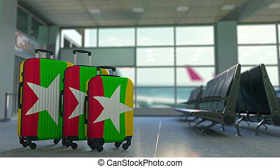 Travel suitcases with flag of Myanmar. Myanma tourism conceptual 3D rendering