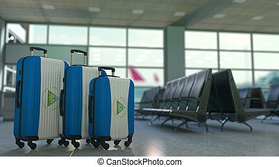 Travel suitcases with flag of Nicaragua. Nicaraguan tourism conceptual 3D rendering