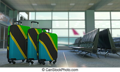 Travel suitcases with flag of Tanzania. Tanzanian tourism conceptual 3D rendering