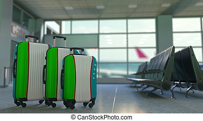 Travel suitcases with flag of Uzbekistan. Uzbek tourism conceptual 3D rendering