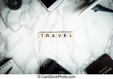 Travel text with accessories on marble surface