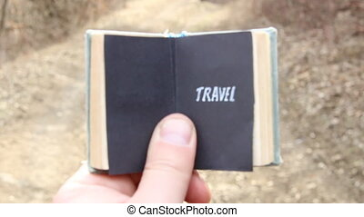 Travel, The traveler holds a book with text
