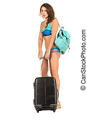 Travel theme. Woman with luggage