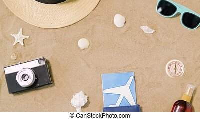 travel tickets, camera and hat on beach sand - vacation,...