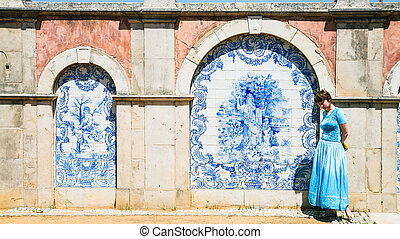 tourist near outside wall of Estoi Palace