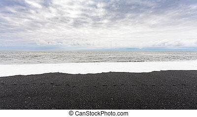 ocean surf on Reynisfjara black sand Beach