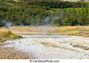pool of big geyser in Haukadalur valley - travel to Iceland...
