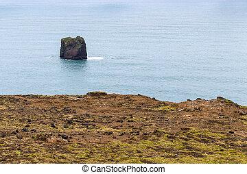 rock in Atlantic ocean near Dyrholaey promontory