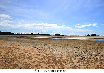 Travel to Island Koh Lanta, Thailand. The view on the sand beach with traces of crabs on a sunny day.