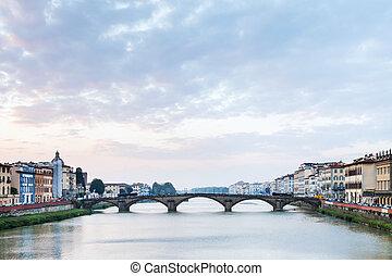 blue and pink sunset clouds over Arno River