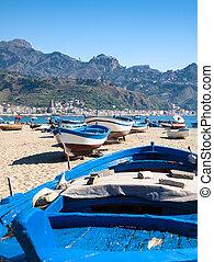 boats on urban beach in Giardini Naxos town - travel to...
