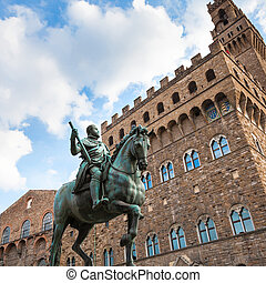 Monument of Cosimo I and wall of Palazzo Vecchio - travel to...