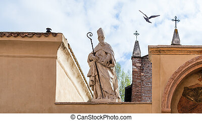 travel to Italy - sculpture of Saint on walls of Church of San Zeno in Oratorio (Chiesa di San Zenetto) in Verona city in spring