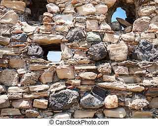 stone wall of ancient castle in Calatabiano