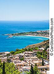 view of Taormina city and giardini naxos beach - travel to...