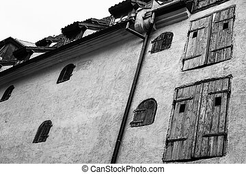 wall of medieval house with wooden blinds in Riga