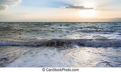 surf at Dead Sea in winter sunset