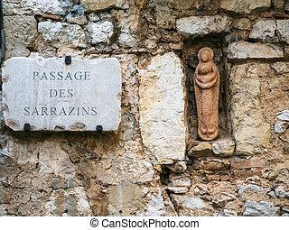 Virgin figurine in wall of medieval house