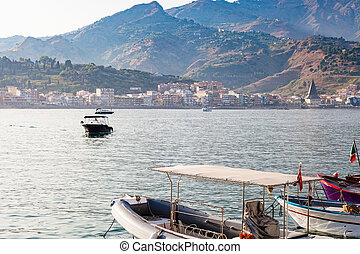 view of Giardini Naxos town from port - travel to Sicily,...