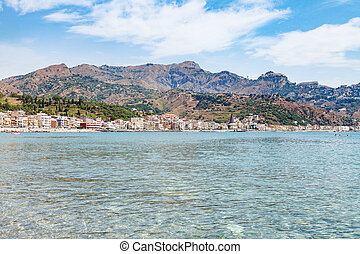 Ionian sea and view of Giardini Naxos town - travel to...