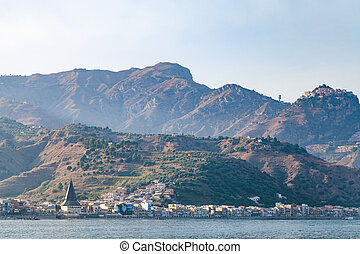 view of Giardini Naxos town in summer sunset - travel to...