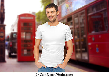 man in blank white t-shirt over london city street