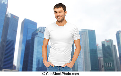 man in blank white t-shirt over singapore city