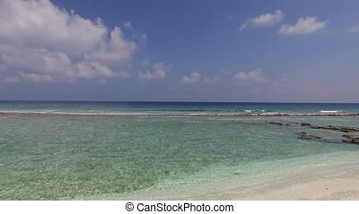 sea and sky on maldives beach - travel, tourism, vacation...