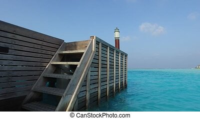berth or terrace with stair in sea water on beach - travel,...